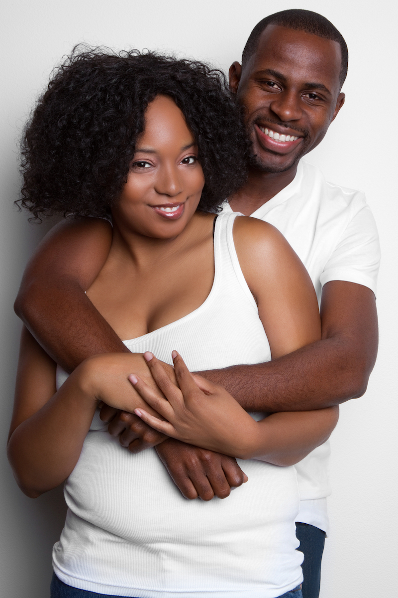 Happy smiling young black couple